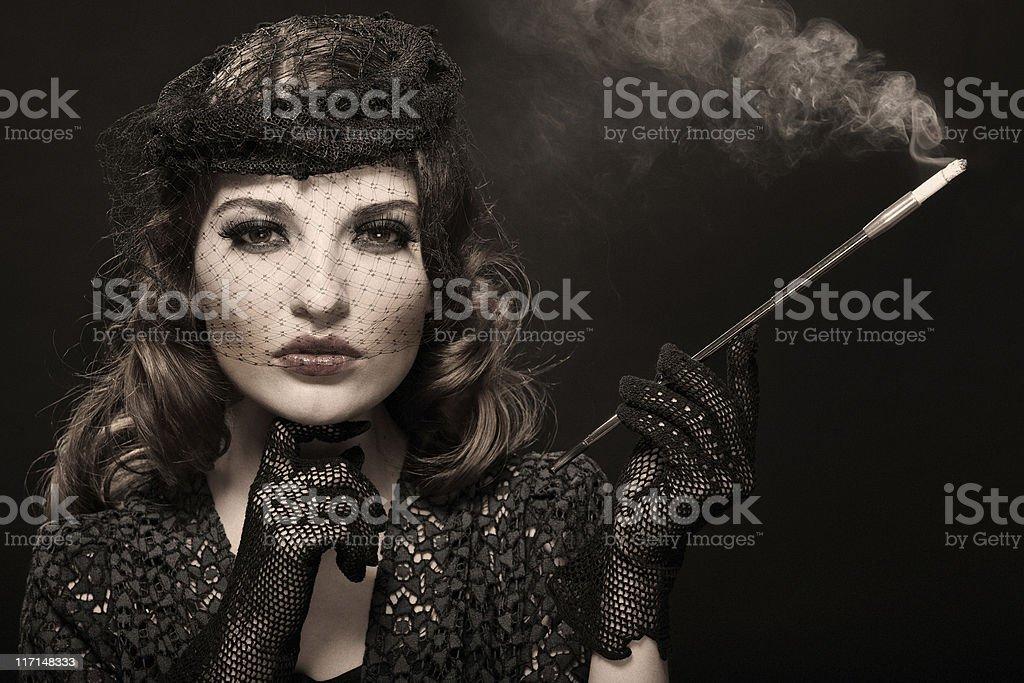 Retro girl with cigarette holder stock photo