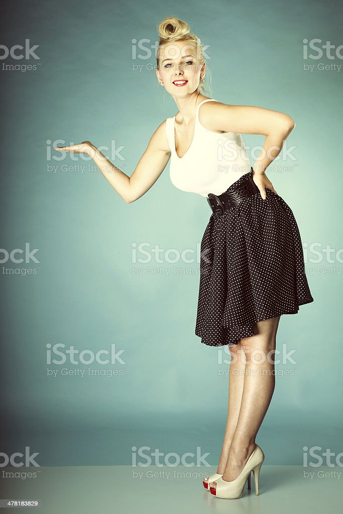 Retro girl with open palm copy space for product stock photo
