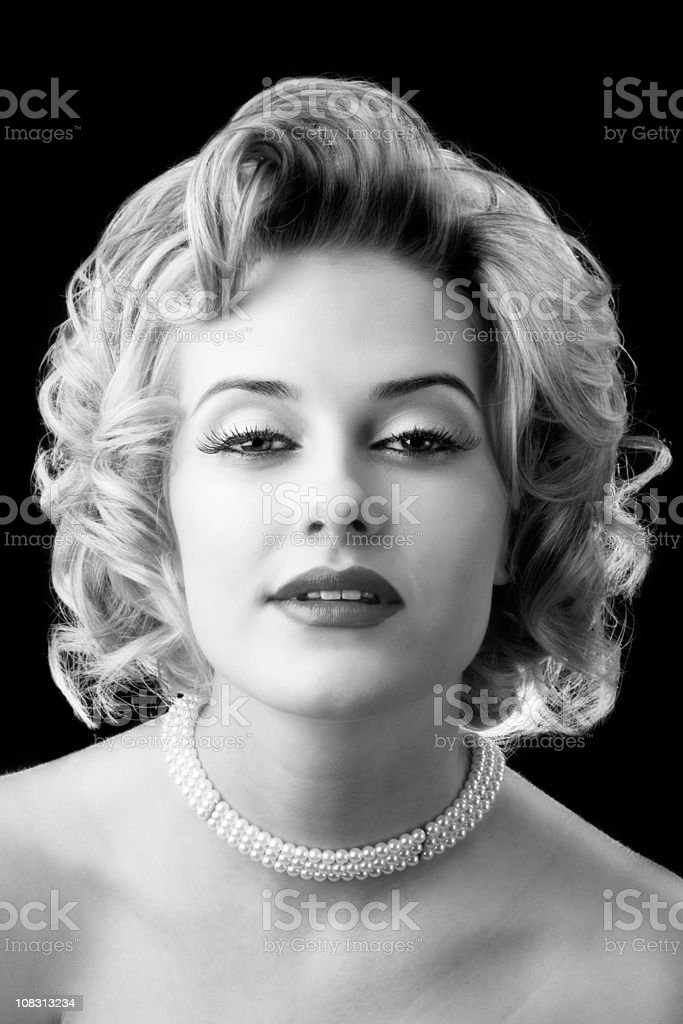 Retro glamor portrait of young beautiful blond woman royalty-free stock photo