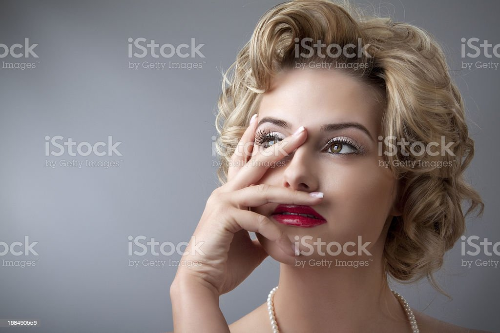 Retro glamor portrait of young beautiful blond woman stock photo
