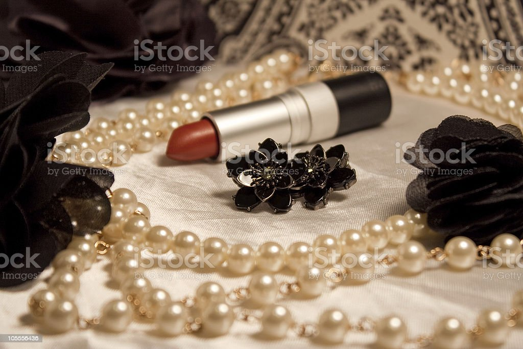 Retro glamour items including lipstick and pearl necklace stock photo
