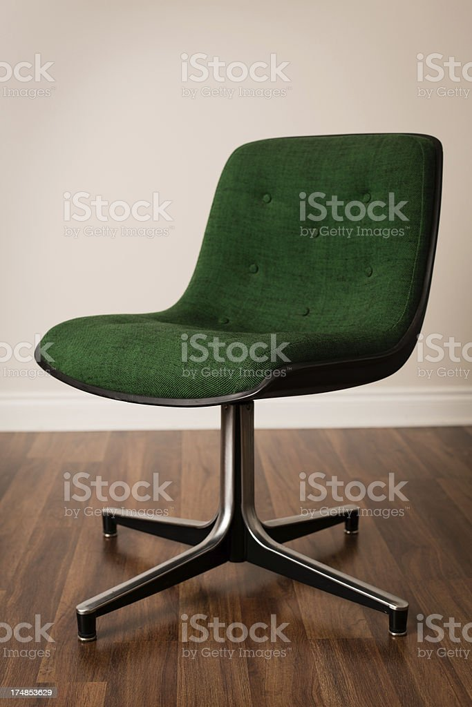 Retro Green Office Chair on Wood Flooring royalty-free stock photo
