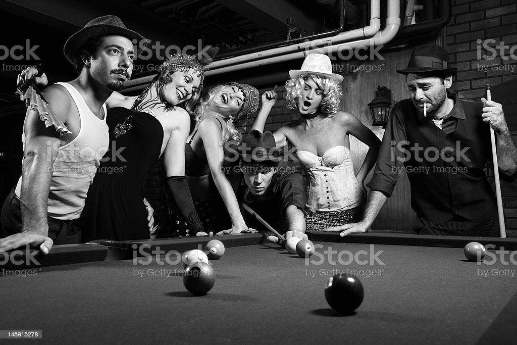 Retro group playing pool. stock photo