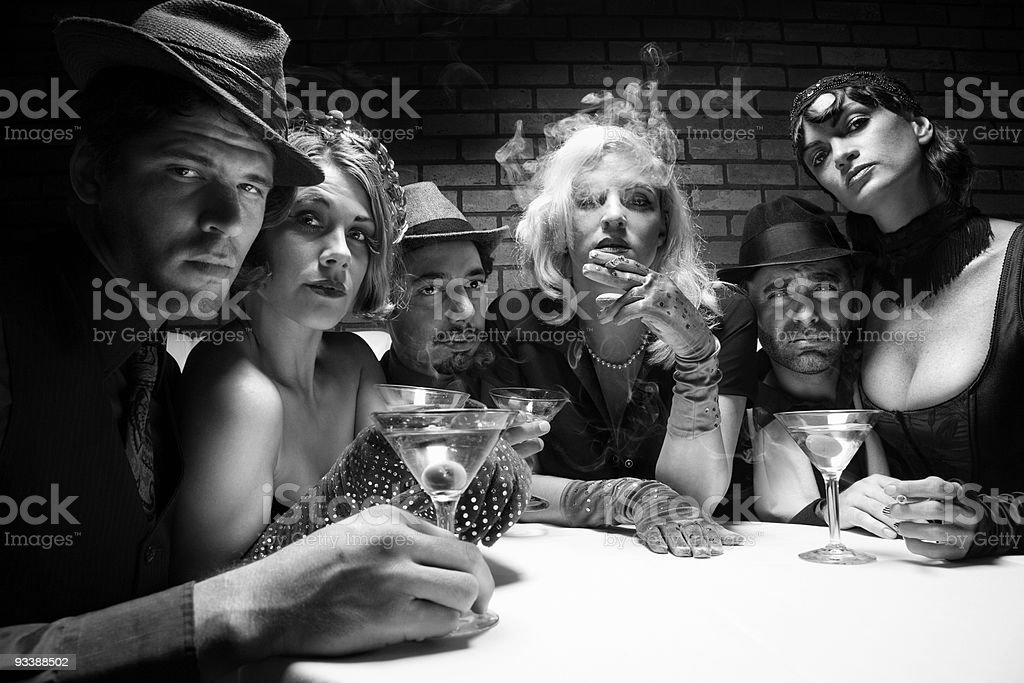 Retro group sitting in bar. stock photo