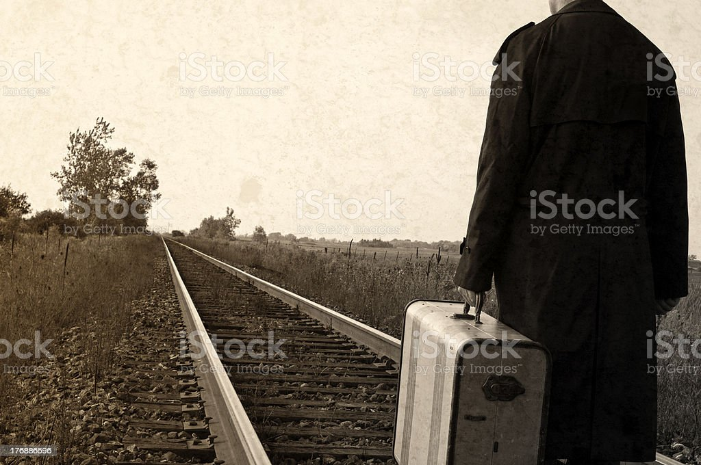 Retro Grunge Hobo, Vintage Suitcase on Train Tracks stock photo