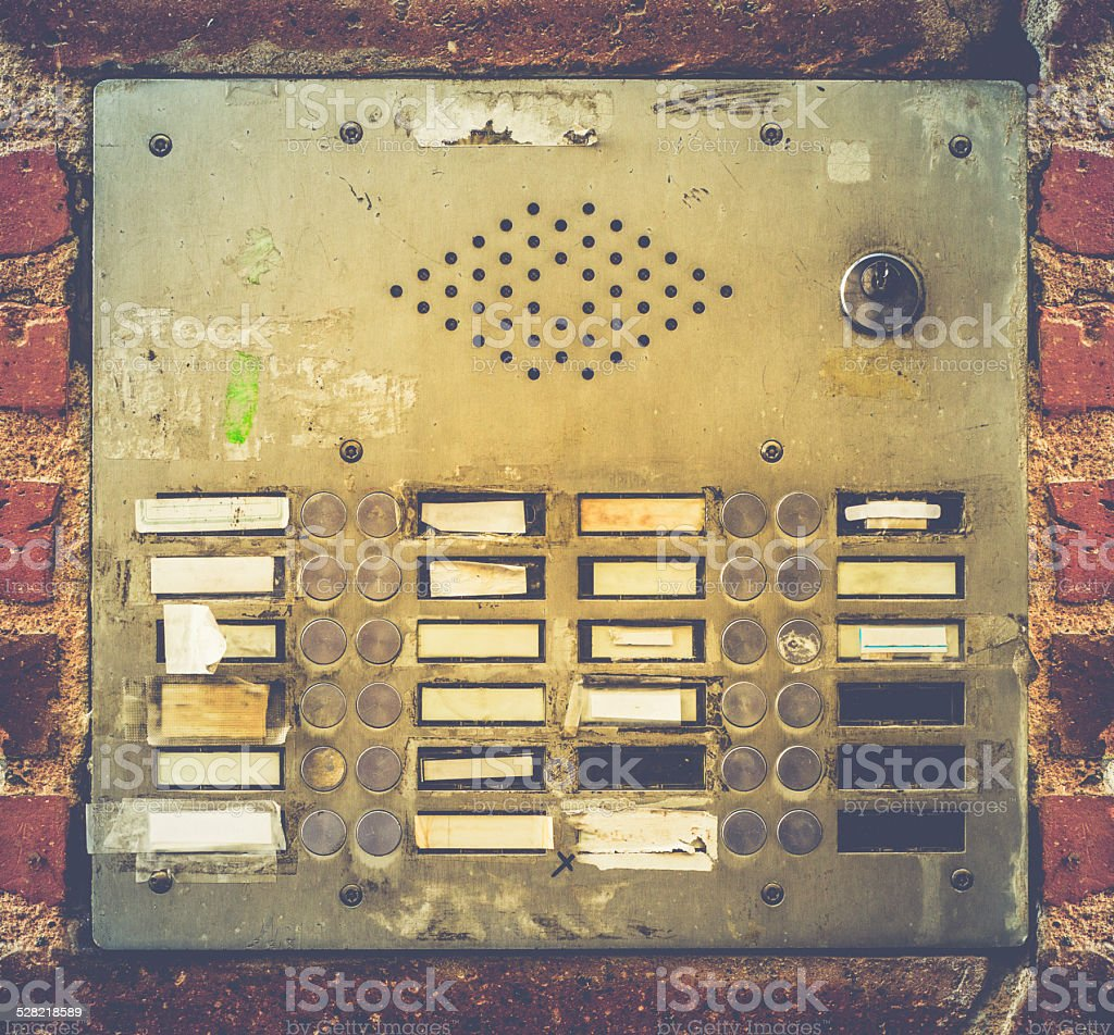 Retro Grungy Apartment Buzzer System stock photo