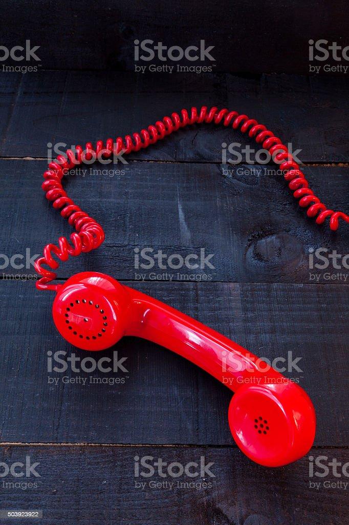 Retro headphones red landline phone on wooden background stock photo