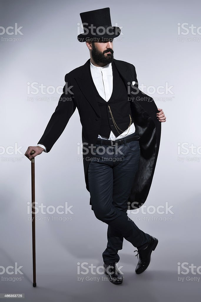 Retro hipster 1900 fashion man in suit with black beard. stock photo