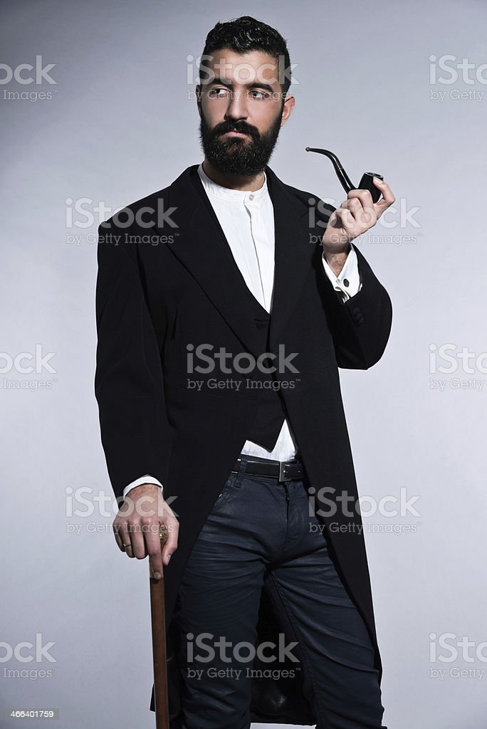 Retro hipster 1900 fashion man with black hair and beard. stock photo