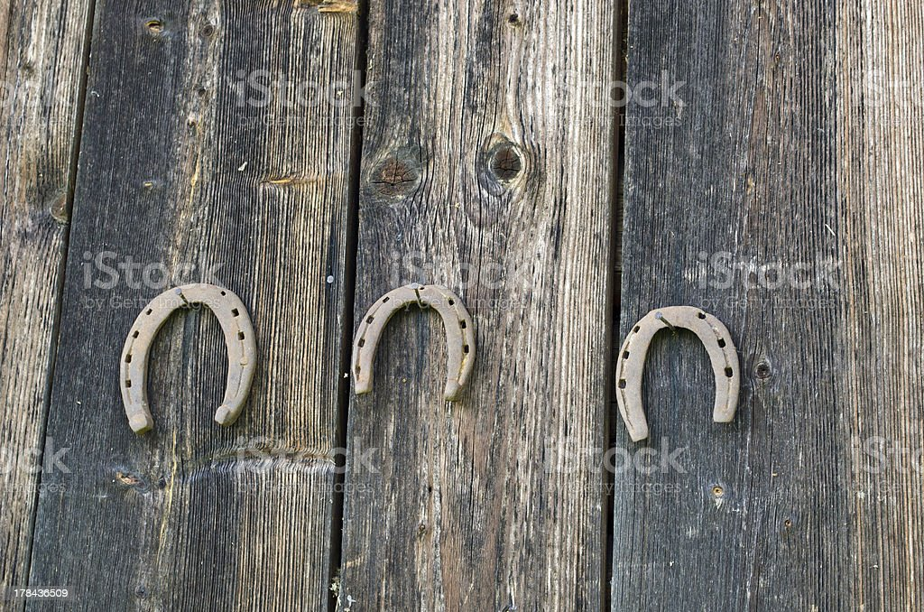 retro horse shoes hang nail wooden rural wall royalty-free stock photo