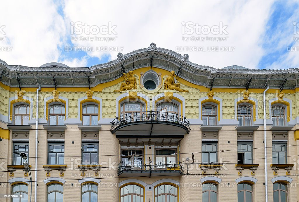 Retro house, decorated the pediment sculptures of women stock photo