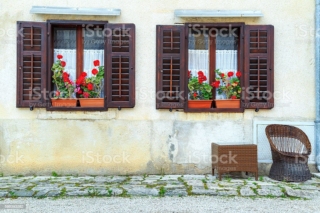 Retro house with colorful fresh flowers stock photo
