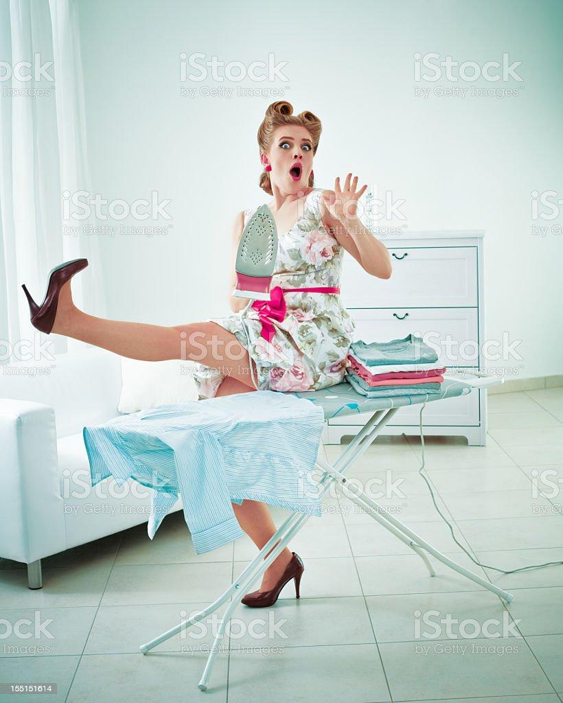Retro housewife ironing royalty-free stock photo