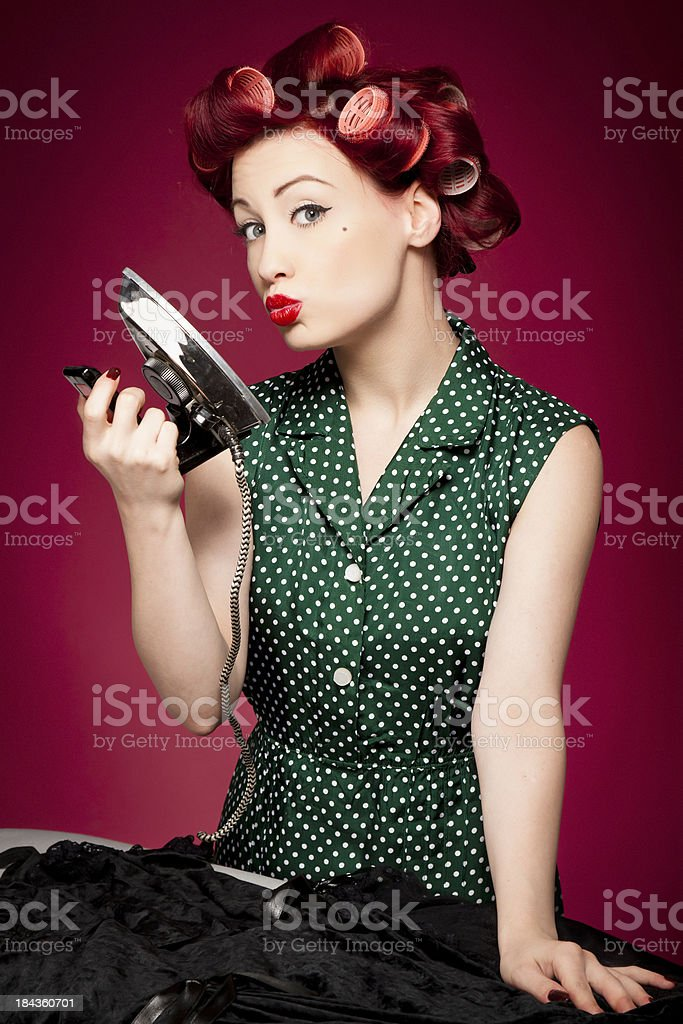 Retro housewife ironing royalty-free stock photo