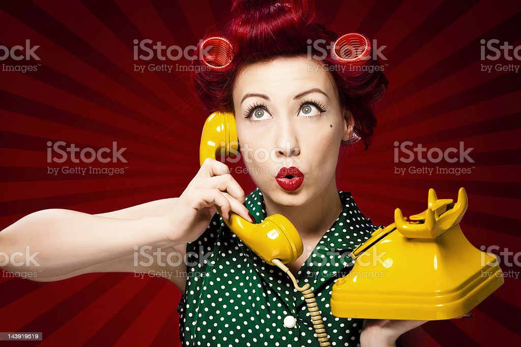 Retro housewife on the phone royalty-free stock photo