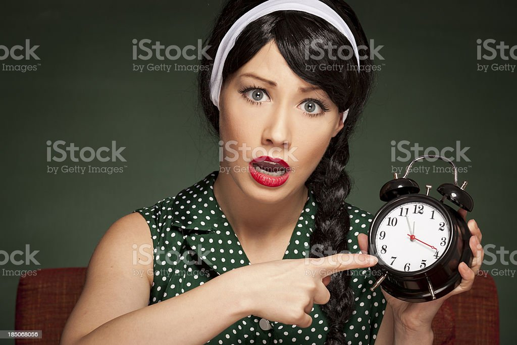 Retro housewife running late royalty-free stock photo