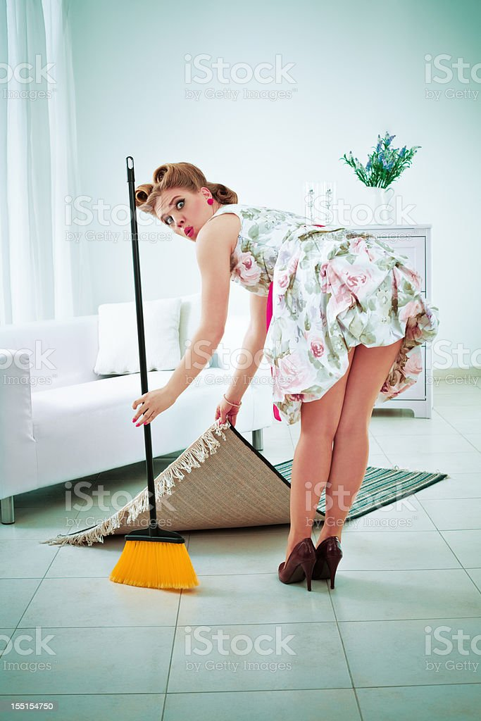 Retro housewife sweeping royalty-free stock photo