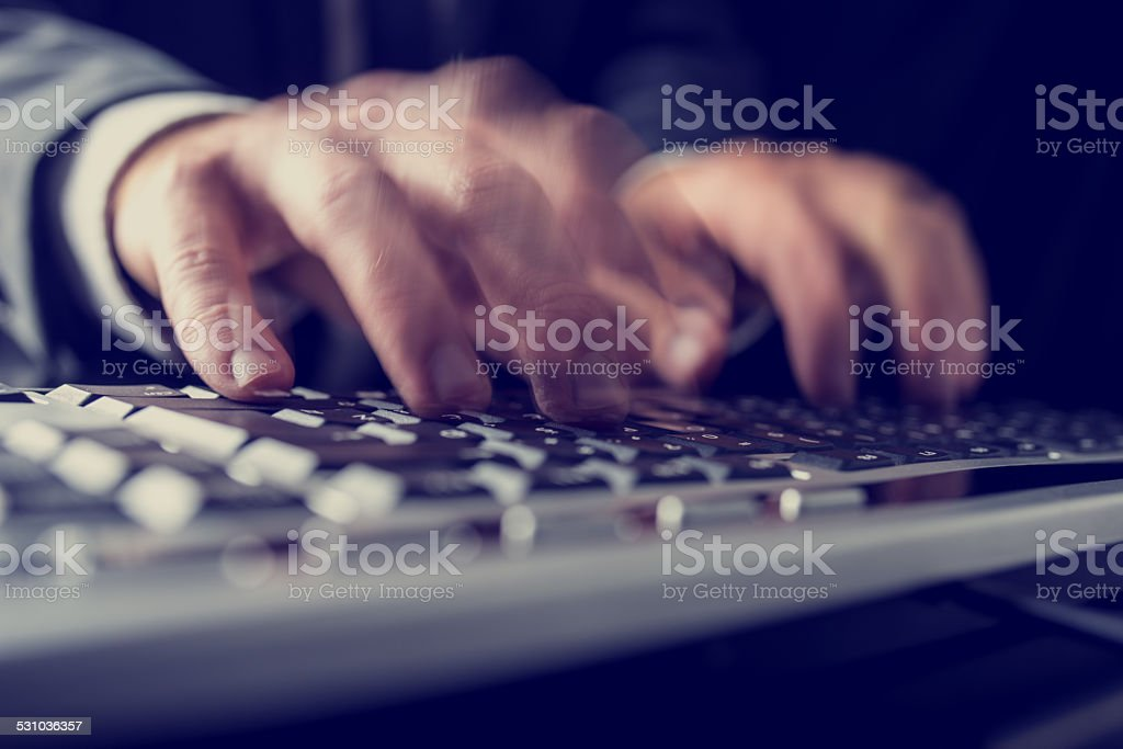 Retro image of a businessman typing on a computer keyboard stock photo