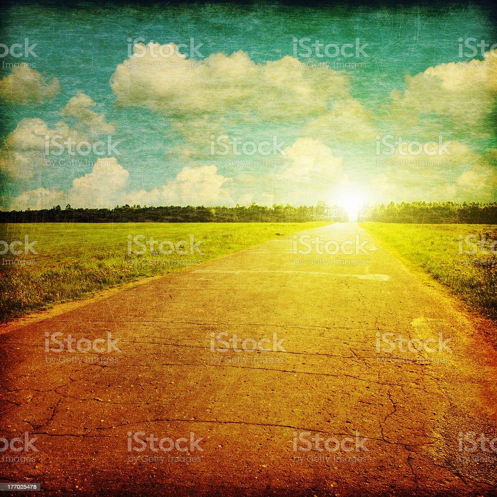 Retro image of rural road at sunset. royalty-free stock photo