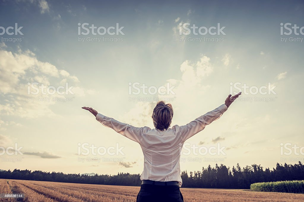 Retro image of victorious young businessman celebrating his succ stock photo