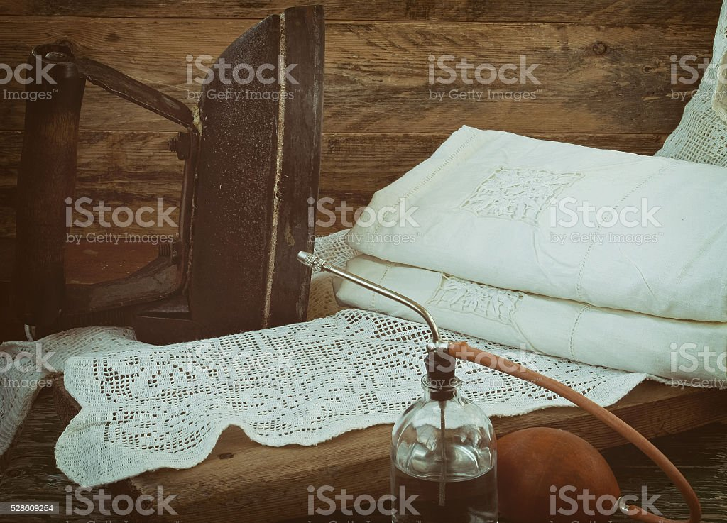retro iron, linen and sprinkler stock photo