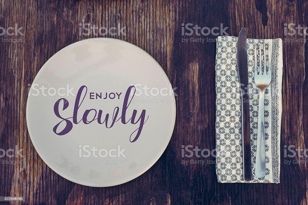 Retro kitchen elements on wood enjoy slowly stock photo