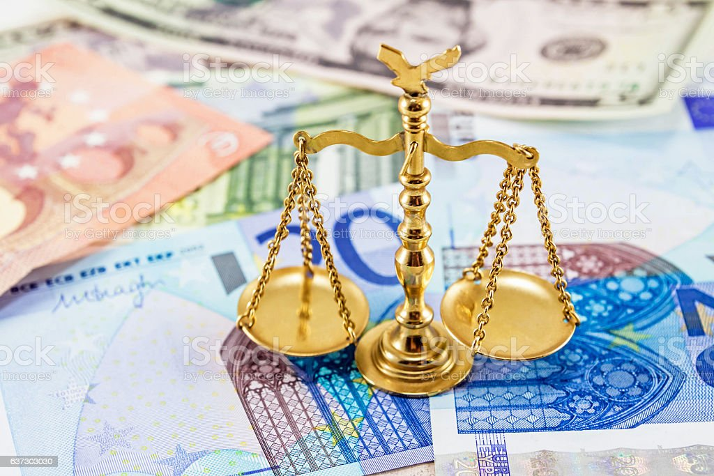 Retro law scales on different banknotes stock photo
