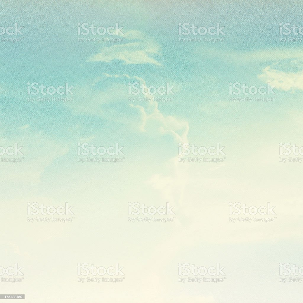 Retro light blue sky and white clouds background stock photo