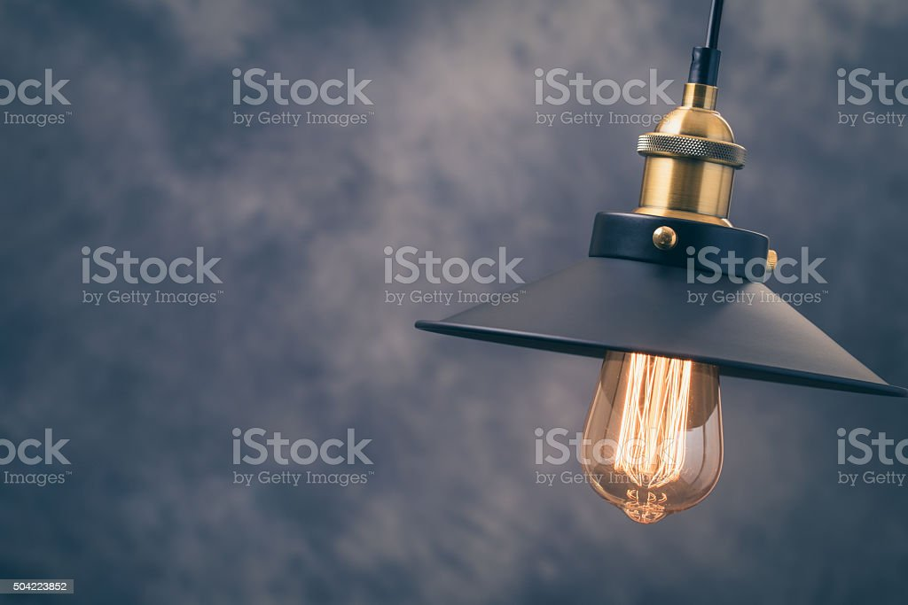 Retro light lamp at right of gray background stock photo