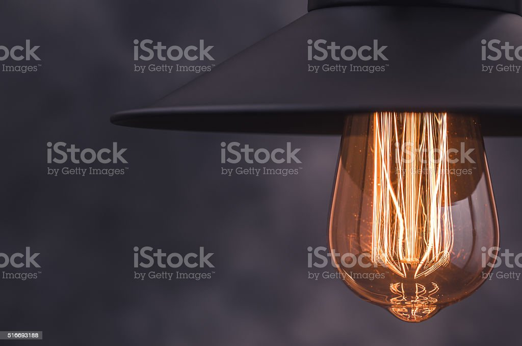 Retro light lamp from right border of gray background stock photo