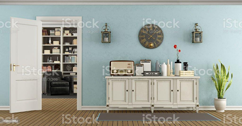 Retro living room with sideboard and open door stock photo