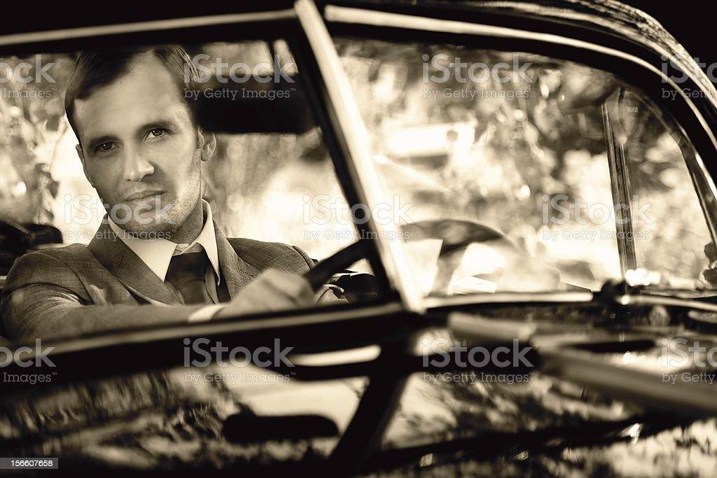 Retro man behind steering wheel royalty-free stock photo