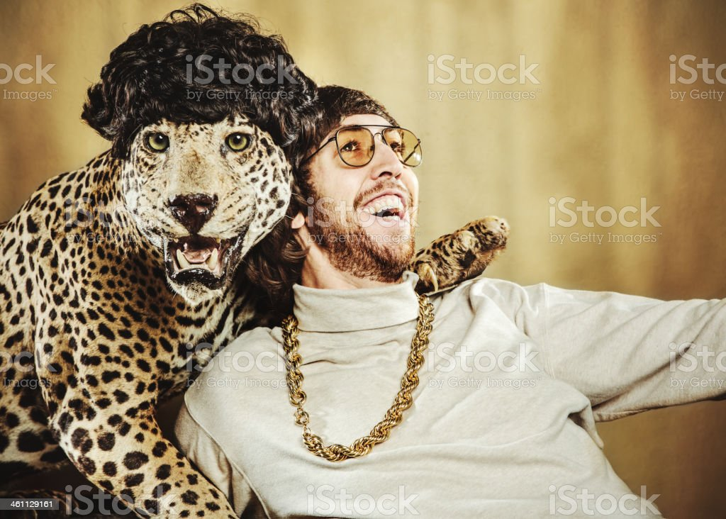 Retro Man Poses with Wig Wearing Leopard stock photo
