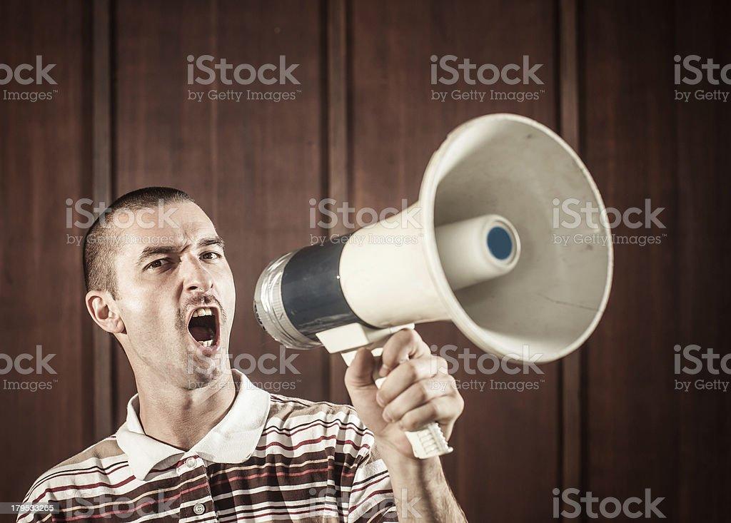 Retro man with megaphone royalty-free stock photo