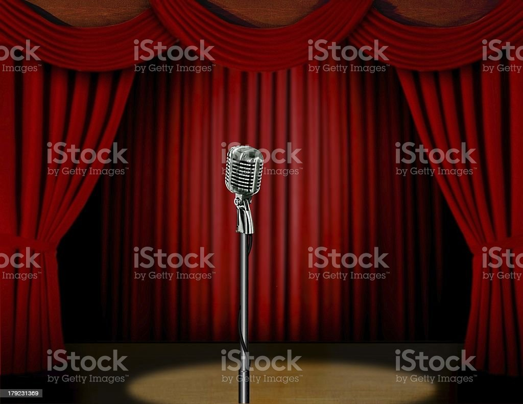 Retro microphone and red curtain on stage royalty-free stock photo
