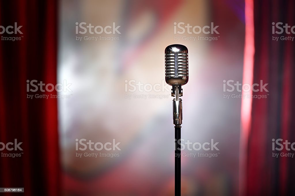 retro microphone and red curtain stock photo