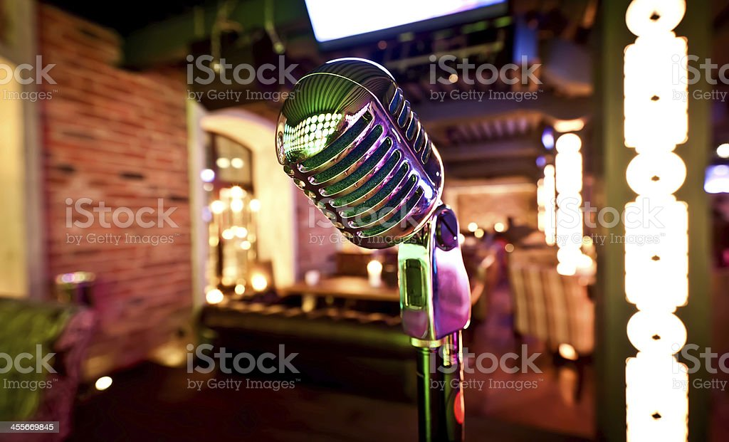 A retro microphone on stage at a venue stock photo