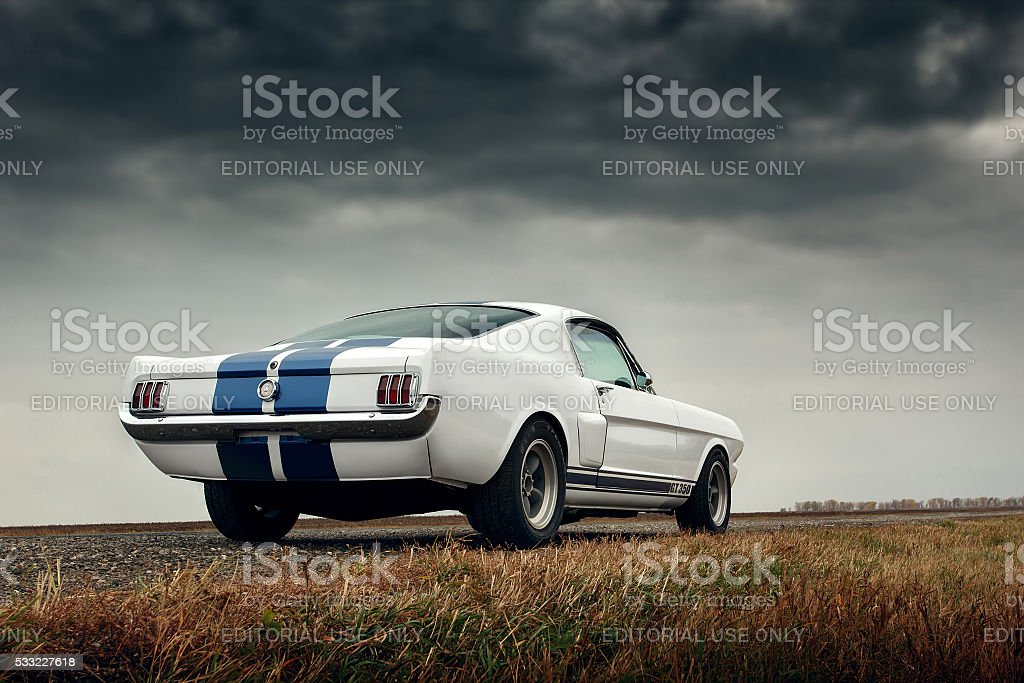 Retro muscle car ford mustang shelby on the road stock photo