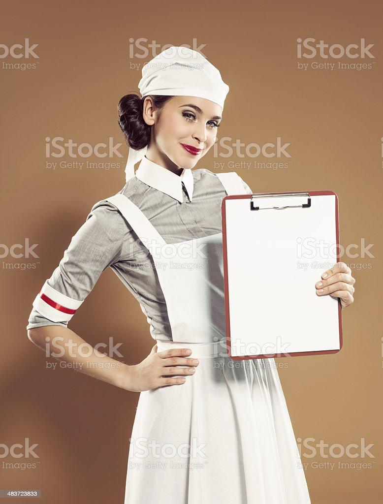 Retro nurse holding binder clip royalty-free stock photo