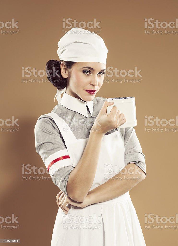 Retro nurse holding tea cup royalty-free stock photo