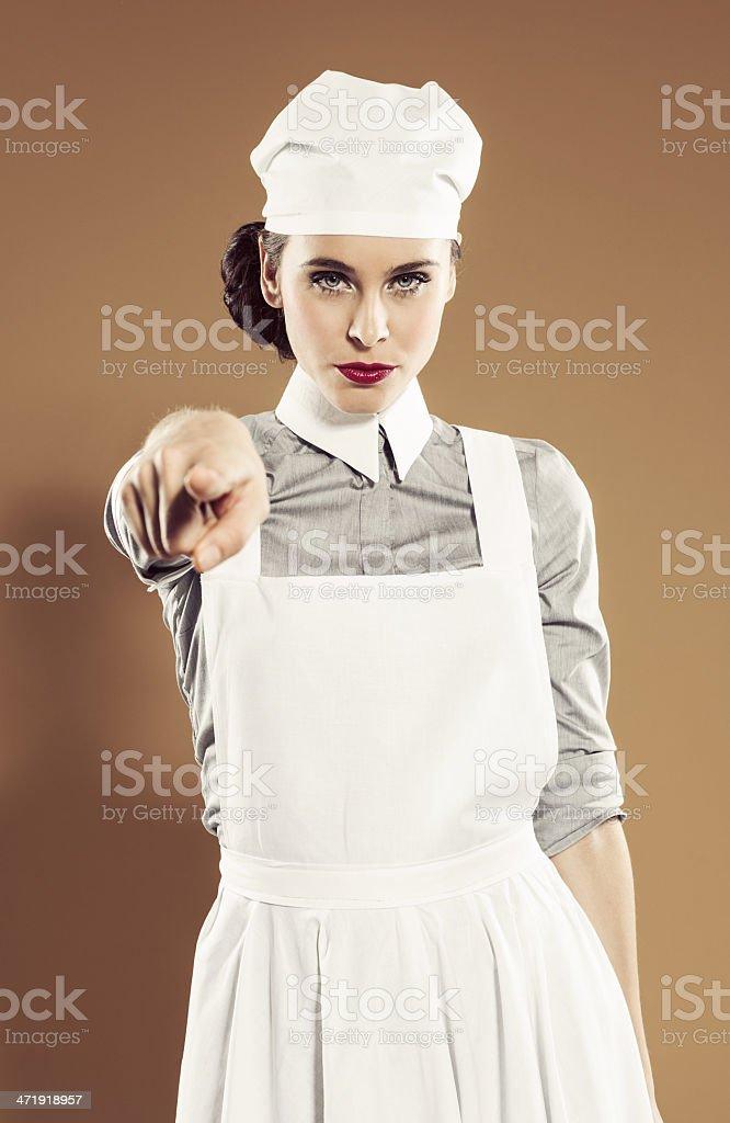 Retro nurse pointing royalty-free stock photo