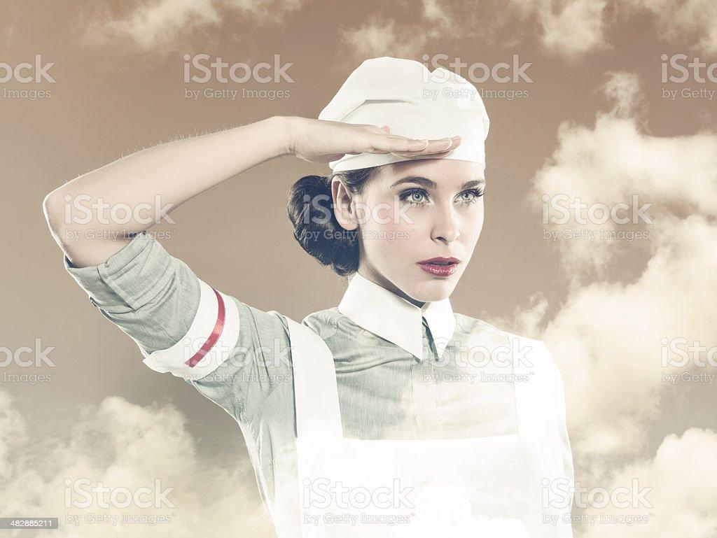 Retro nurse saluting royalty-free stock photo