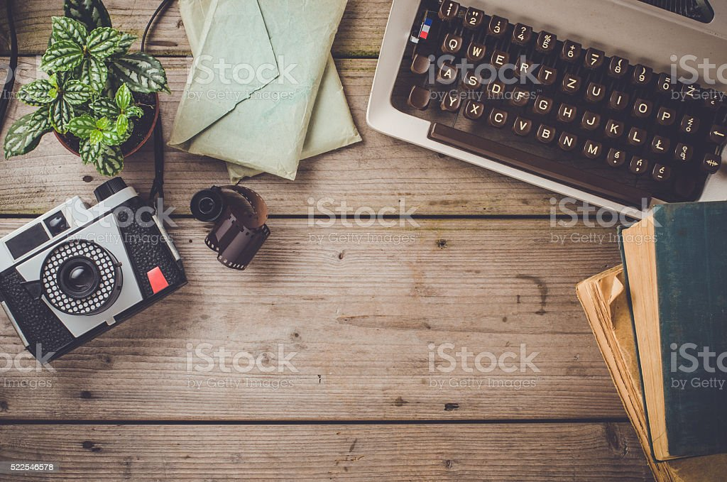 Retro objects on wooden table stock photo