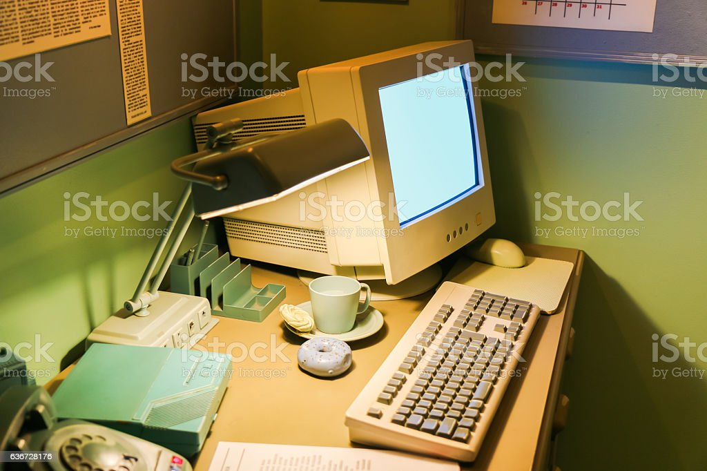 Retro office desk in dark room with simulator object. stock photo