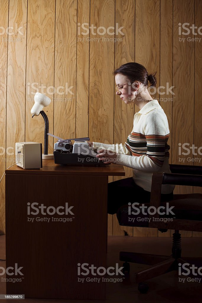Retro Office Receptionist Working Late Hours royalty-free stock photo