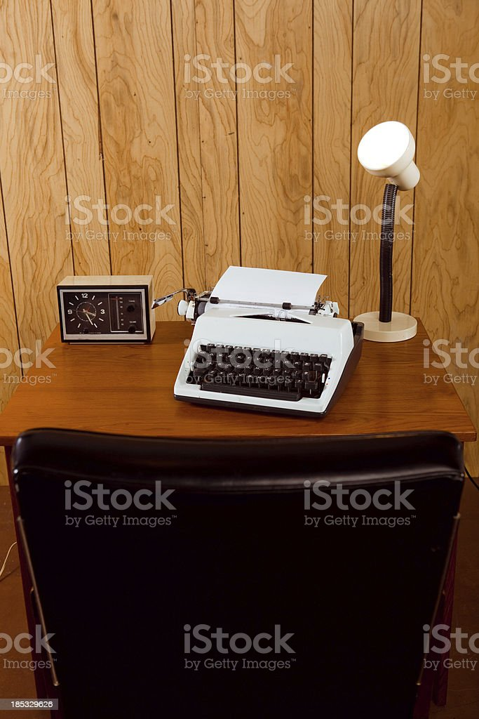 Retro office with back of leather chair in foreground royalty-free stock photo