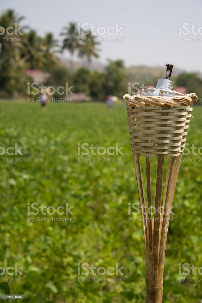 Retro oil lamp in bamboo cwicker  on urban country royalty-free stock photo