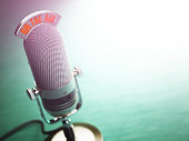 Retro old microphone with text on the air. Radio show