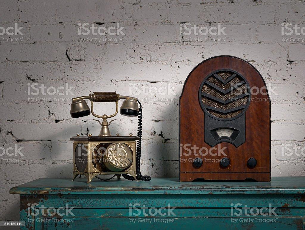 Retro old wooden radio and old telephone set stock photo