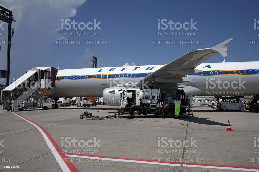 Retro painted Lufthansa Airbus being refueled on airfield position stock photo